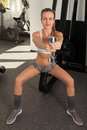 Athletic young woman with dumbbell Royalty Free Stock Photo