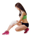 Athletic young woman with elastic bandage on his leg isolated white background Stock Image