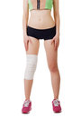 Athletic young woman with elastic bandage on his leg isolated white background Royalty Free Stock Photo