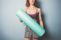 Athletic young woman with foam roller Royalty Free Stock Photo