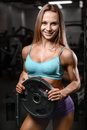 Athletic young woman model posing and exercising fitness workout Royalty Free Stock Photo