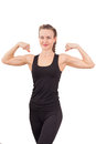 Athletic young woman showing biceps Stock Photo