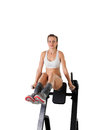 Athletic young woman training press on exerciser Royalty Free Stock Photos
