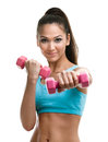Athletic young woman works out with dumbbells Stock Photography