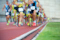 Athletics people running on the track field Royalty Free Stock Photo