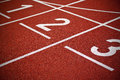 Athletics start track lanes of a red running racing Royalty Free Stock Photography