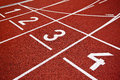 Athletics start track lanes of a red running racing Stock Images