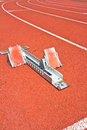 Athletics starting blocks red running track Stock Photos