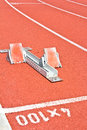 Athletics starting blocks on a red running track Royalty Free Stock Photography