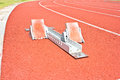 Athletics starting blocks on a red running track Royalty Free Stock Photo