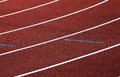 Athletics track turn the race an with red tartan surface Royalty Free Stock Photo