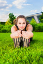 Athletics young woman stretching in the park in summer Stock Images
