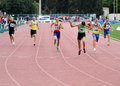 Athlets compete in 400 meters race Royalty Free Stock Image