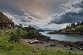 Atlantic Ocean inlet under heave skies, Scotland.