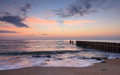Atlantic ocean sunrise north carolina background of on the outer banks near the groyne in buxton Stock Images