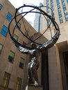 Atlas statue sculpture of carrying a globe in front of the rockefeller center in nyc Stock Images