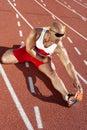 Atleta de sexo masculino stretching on racetrack Fotografía de archivo libre de regalías