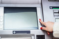 Atm machine woman s finger pressing buttons on Royalty Free Stock Photo