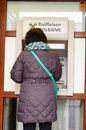 Atm machine woman taking cash from a in swiecie poland Stock Photography
