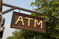 Atm sign a wooden in laos south east asia Royalty Free Stock Photos