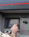 Atm withdraw man selecting amount to from Royalty Free Stock Photography