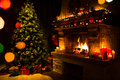 Atmospheric christmas card with tree, presents and fireplace Royalty Free Stock Photo