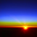 Atmospheric sunrise above the earth Stock Photography