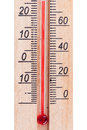 Atmospheric wooden thermometer closeup on white background Royalty Free Stock Images