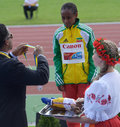 Ato boldon on th iaaf world youth championships donetsk ukraine july ambassador hand over silver medal for m race to berhan Stock Images