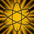 Atom symbol on sunburst design with bright yellow and black Royalty Free Stock Photography