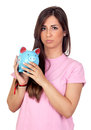 Atractive girl with a blue piggy-bank Stock Image