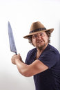 Attacker with big knife a very angry looking man is holding a very looking straight in the camera picture dodge and burn effect Royalty Free Stock Photography