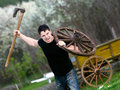 Attacking young man portrait of with an ax in his hand Royalty Free Stock Photos