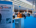Attendee visits stand of Locoslab company at CeBIT Royalty Free Stock Photo