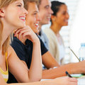 Attentive business people sitting in a row Stock Image