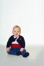 Attentive cute little baby boy in tuxedo Royalty Free Stock Photo