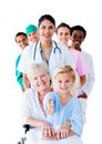 Attentive medical team taking care of a senior Royalty Free Stock Photo