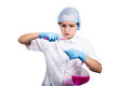 Attentive schoolgirl conducting a chemistry experiment at elementary science class Royalty Free Stock Photo