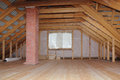 Attic with chimney in wooden house under construction overall view interior Stock Photography