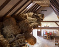 Attic photo of construction in rustic restaurant with bale of straw Royalty Free Stock Images