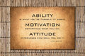 Attitude quote by Lou Holtz over bamboo background Royalty Free Stock Photo