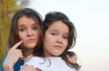 Always with attitude two teenage girls specify age Royalty Free Stock Photos