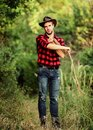 Attle breeding concept. Cowboy at countryside. Ranch occupations. Man cowboy nature background. Man wearing hat hold Royalty Free Stock Photo