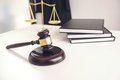 Attorney`s suit, Law books, a gavel and scales of justice on a w Royalty Free Stock Photo