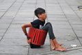 Attraction of body flexibility a man inserting his into the barrel while busking in jakarta indonesia required the to perform the Royalty Free Stock Images