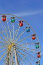Attraction colorful ferris wheel against the blue sky Royalty Free Stock Photography