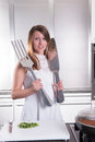 Attractiv young woman with big fork and knife Royalty Free Stock Photo