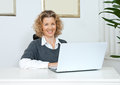 Attractive adult woman with laptop Stock Photography