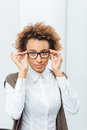 Attractive african american businesswoman in glasses standing in office Royalty Free Stock Photo
