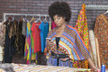 Attractive African American female fashion designer using cell phone Royalty Free Stock Photo